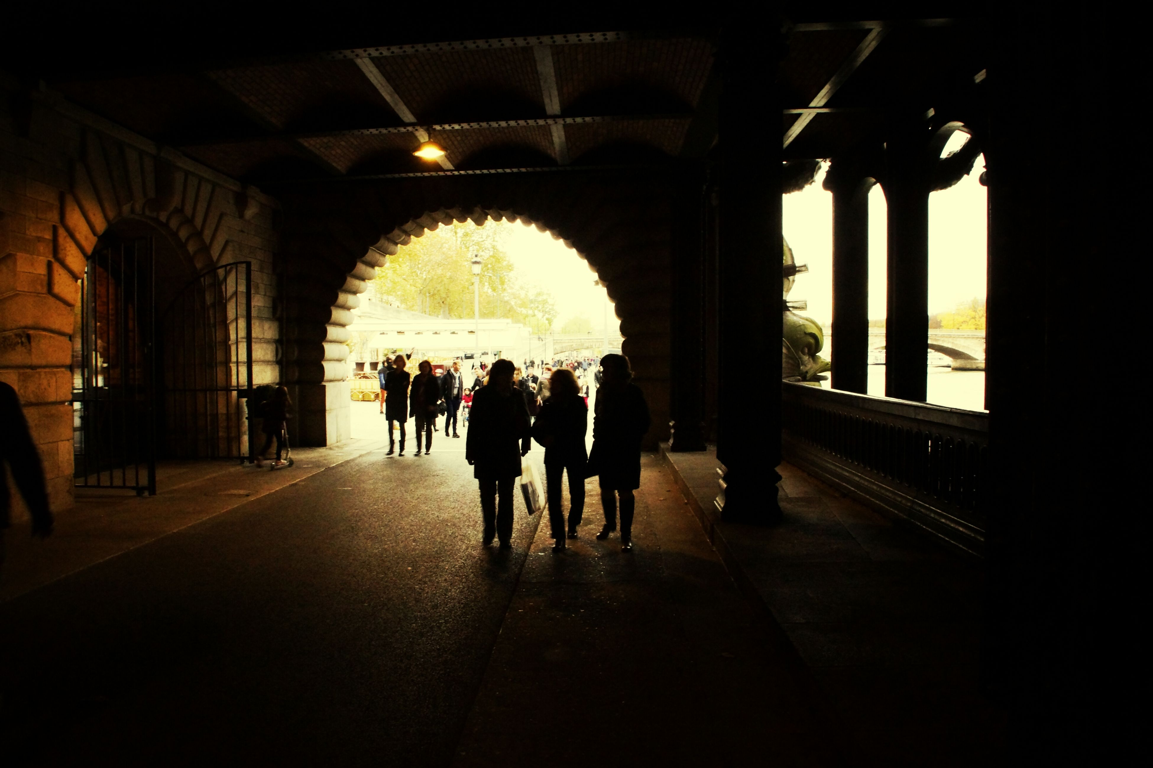indoors, arch, men, architecture, person, lifestyles, built structure, large group of people, walking, silhouette, leisure activity, medium group of people, full length, tourist, travel, architectural column, group of people, mixed age range, togetherness