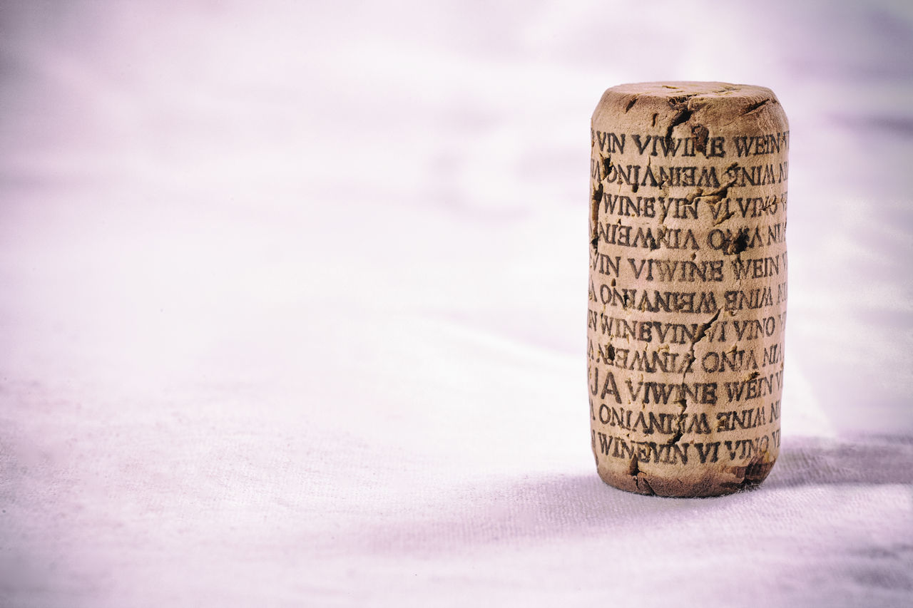 Wine cork with word wine in several languages. Isolated. Vintage filtered Close-up Communication Cork - Stopper Day No People White Background Wine Cork