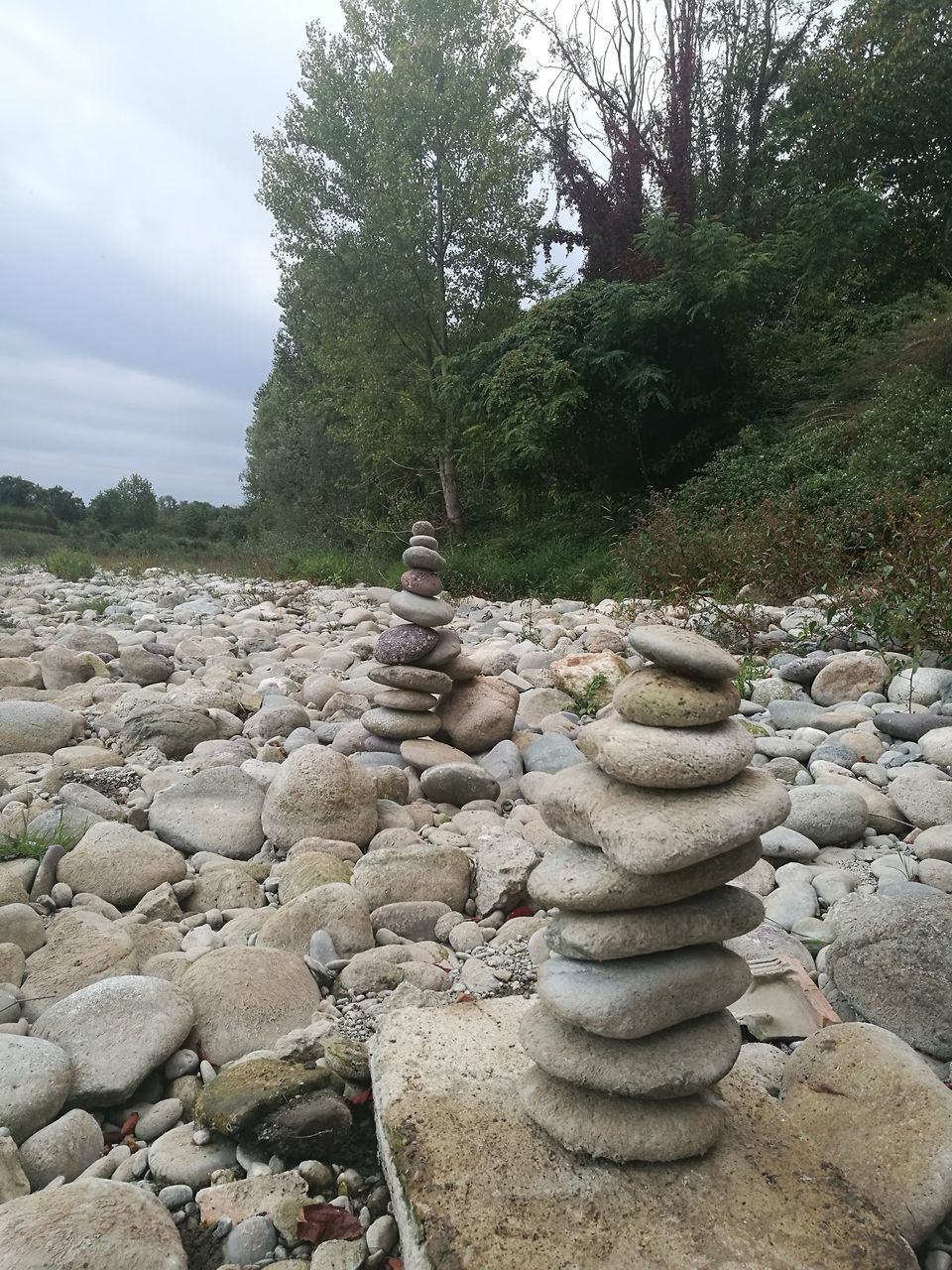 tree, stack, rock - object, nature, day, tranquility, tranquil scene, balance, outdoors, pebble, no people, beauty in nature, landscape, scenics, sky, water