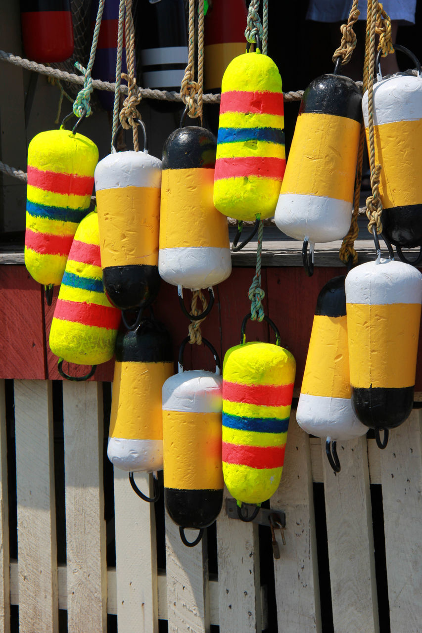 multi colored, hanging, no people, safety, rope, outdoors, variation, day, close-up