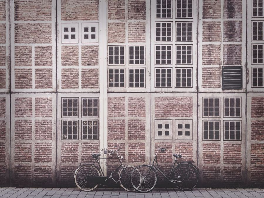 Bikes on a Walll Bikes Bikesaroundtheworld Bikes Of Amsterdam Cycle Wall Wall - Building Feature Pattern Pattern, Texture, Shape And Form Patterns & Textures Building Exterior Pair Two Simple VSCO Vscocam Showcase April Your Amsterdam