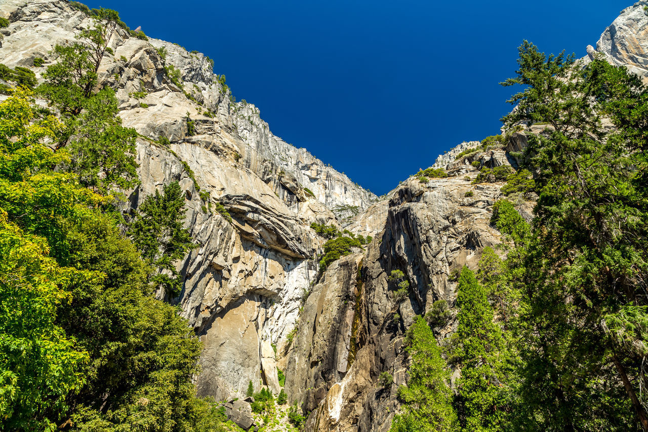 Beauty In Nature Blue Blue Sky Mountain Mountain Range Nature No People Outdoors Sky Tranquil Scene Tranquility Tree