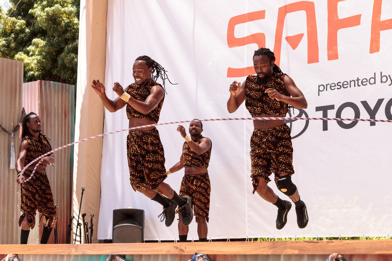 San Diego, CA, USA - July 1, 2017: Acrobatic performance of the Zuzu African acrobats at the San Diego Zoo Safari park. Editorial only. Acrobat Acrobatic African African Safari Athlete Athletic Dance Jump Kenyan Limbo Performance Performer  Safari Park San Diego Zoo Strength Young Man Zuzu