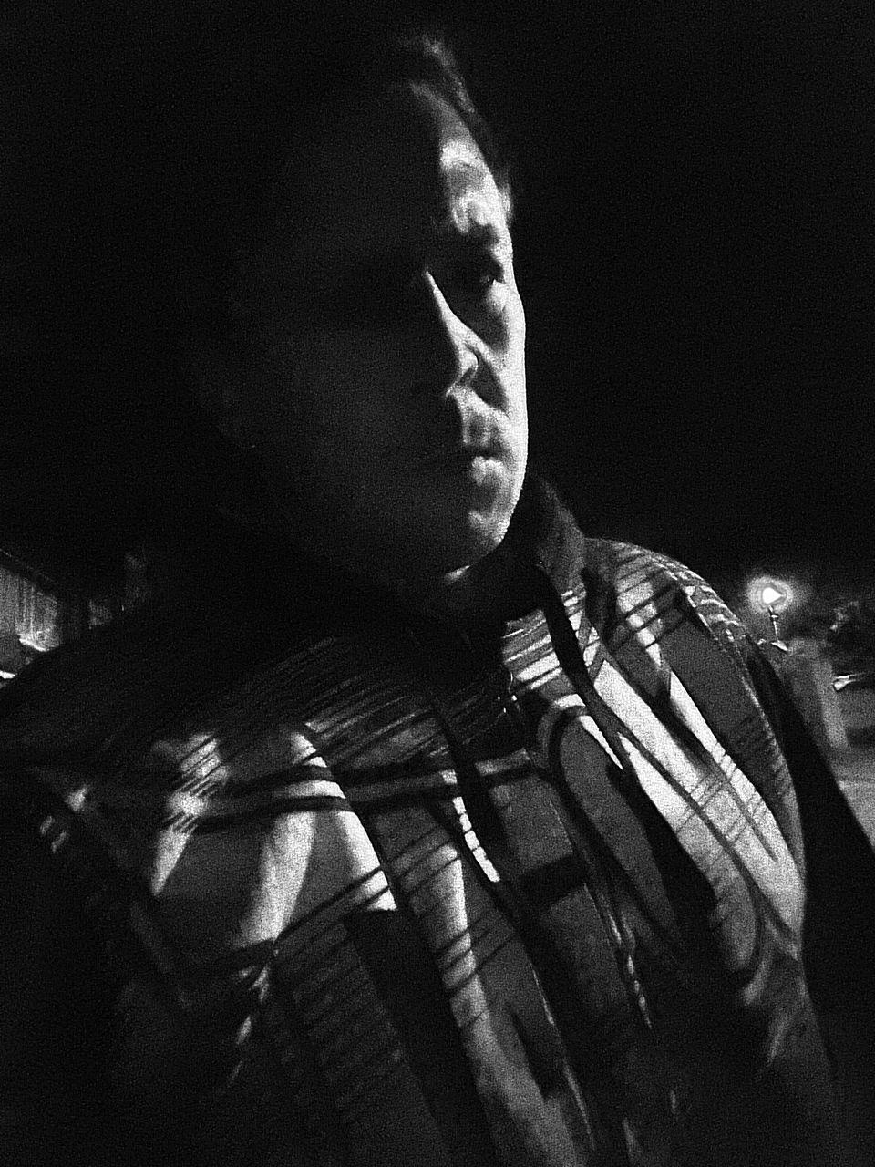 Portrait Of Man At Night