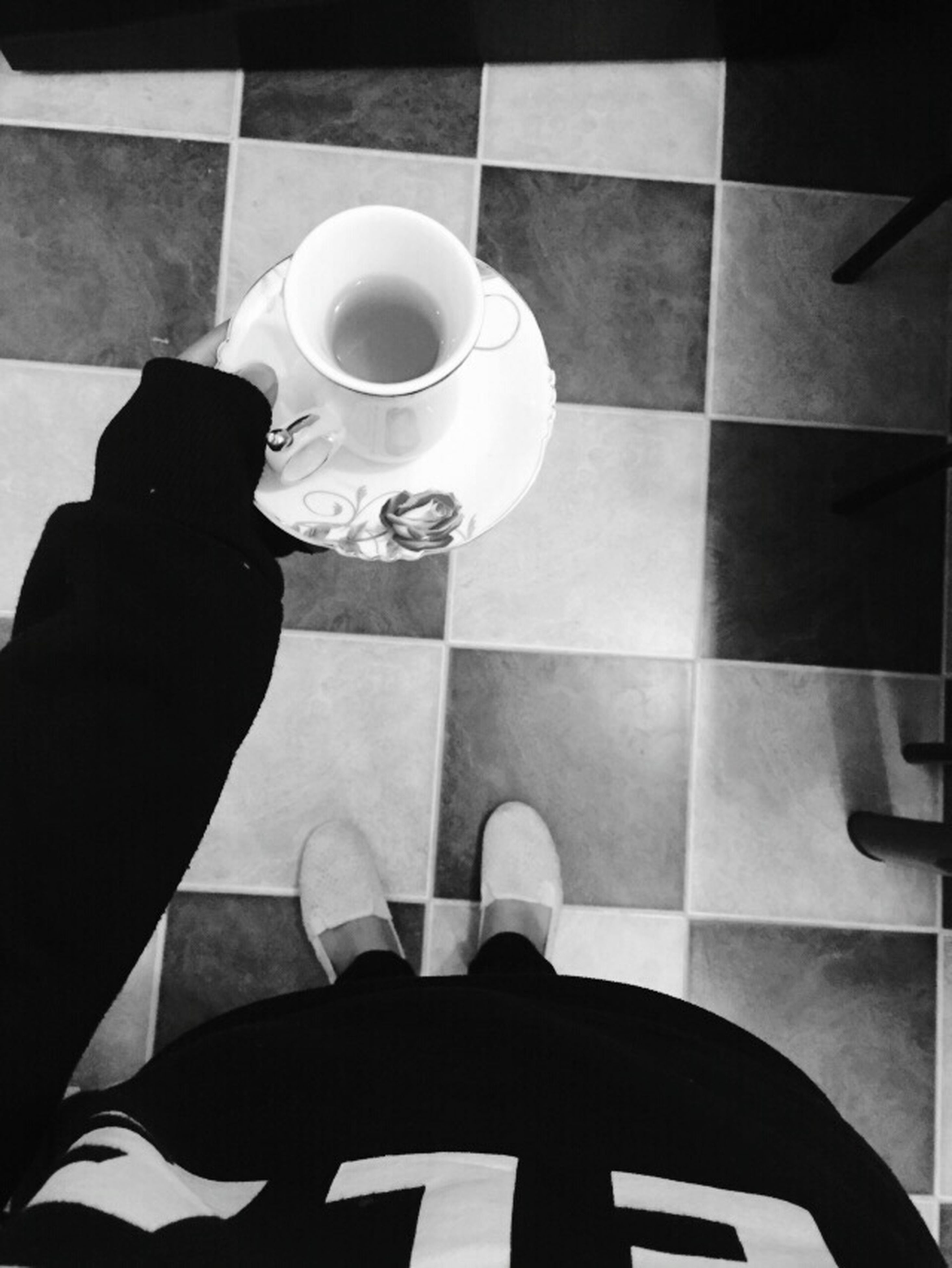 food and drink, coffee cup, indoors, drink, refreshment, coffee - drink, table, coffee, high angle view, cup, freshness, still life, saucer, shadow, directly above, close-up, spoon, tea cup