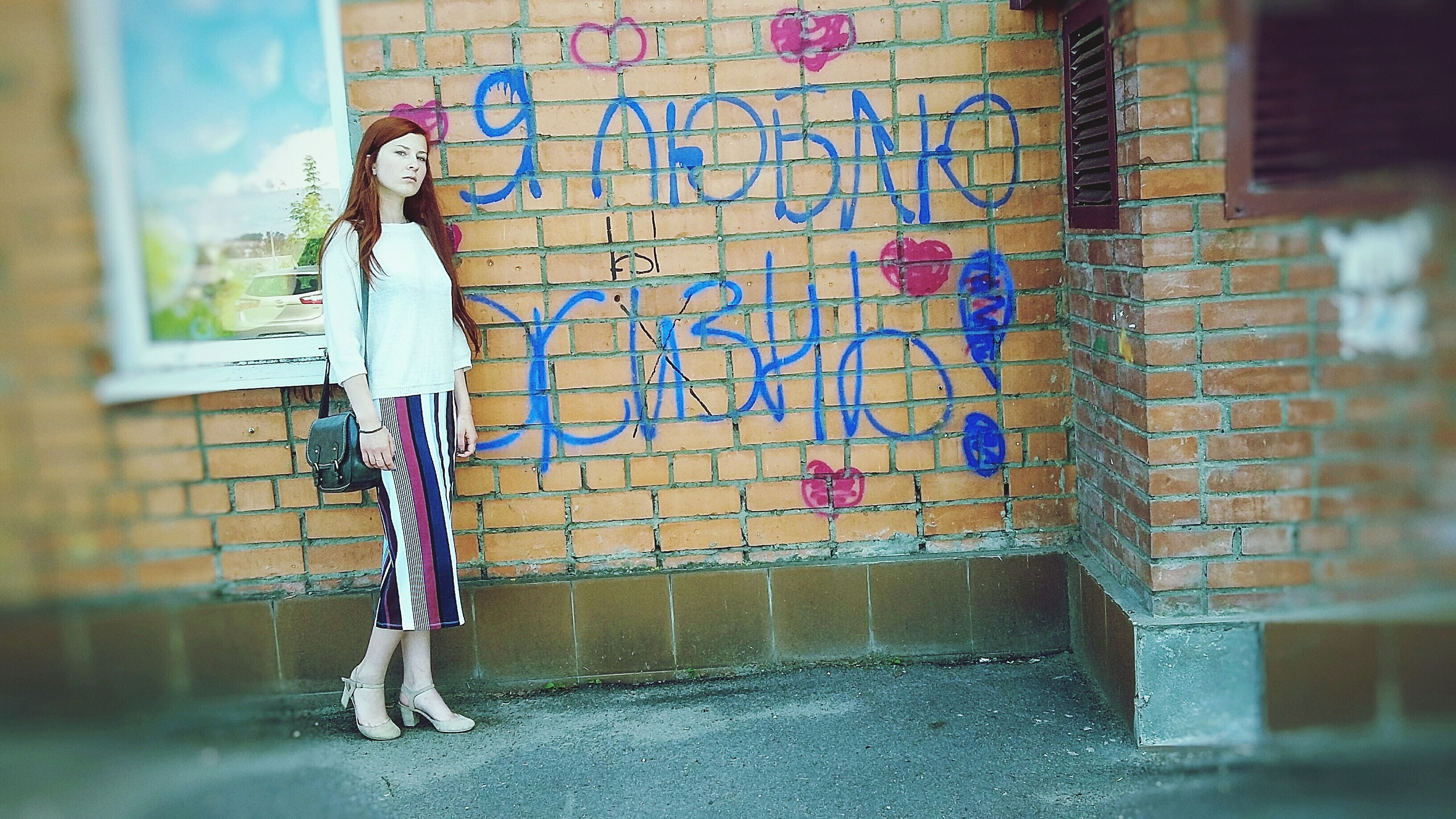 wall - building feature, graffiti, art, wall, lifestyles, casual clothing, painting, day, multi colored, blue