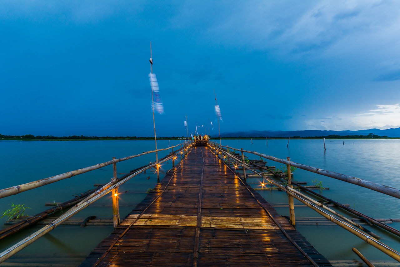 PHAYAO, THAILAND - JULY 19, 2016: The bamboo bridge, The bamboo bridge of Wat Ti Lok Aram temple in kwan phayao off freshwater lake of Thailand. Day is the important Buddhist. ASIA Bamboo Bridge Blue Buddhist Built Structure Cloud - Sky Diminishing Perspective Engineering Important Kwan Phayao Nature No People Outdoors Scenics Sky Temple Thailand The Way Forward Tourism Tranquil Scene Tranquility Travel Destinations Vanishing Point Wat Ti Lok Aram Water