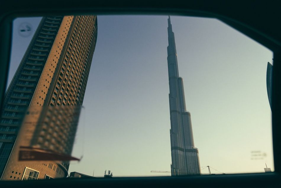 Architecture Built Structure City Building Exterior Tower Skyscraper Travel Destinations Low Angle View Clear Sky No People City Life Outdoors Sky Day Taxi Car Window Burj Khalifa
