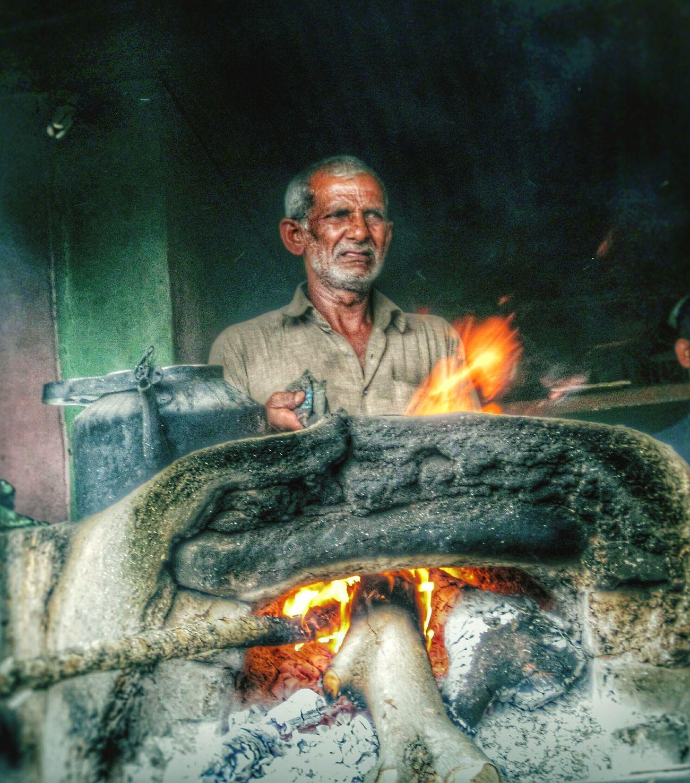Working hard. Hardwork HDR Eyeemedits Rural Scenes India Fire Stove Tea Tea_maker Chaiwala Feel The Journey