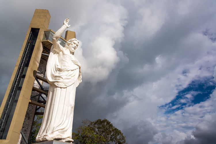 View of the impressive El Santisimo statue of Jesus Christ in Floridablanca, Colombia Architecture Bucaramanga Building Catholic Catholicism Cerro Christianity City Cloud Clouds Ecoparque Elsantisimo Floridablanca Hill Jesuschrist Landmark Mountain Religion Santander Santisimo Scupture Statue Tourism Urban White