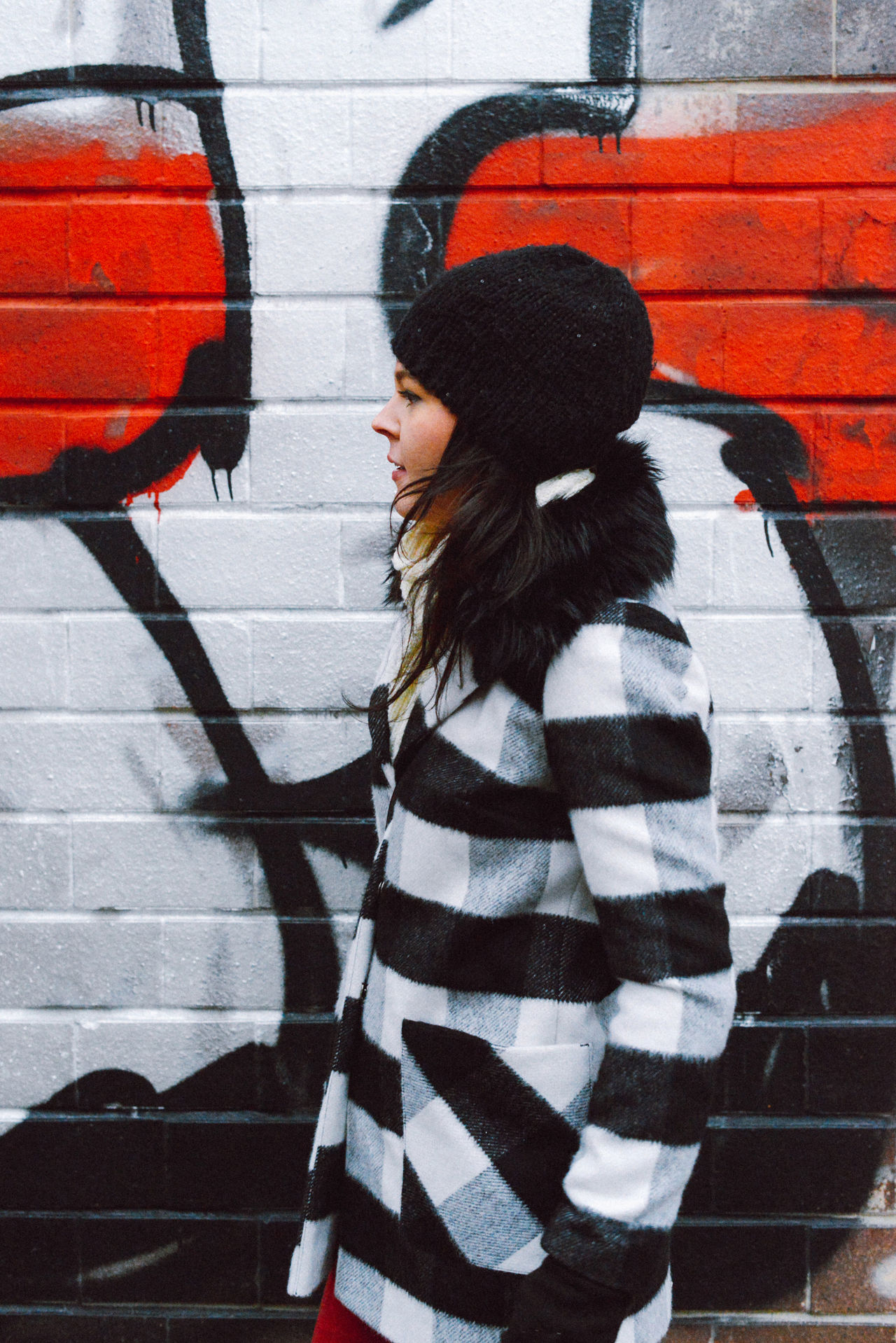 Adapted To The City Brick Wall Cold Cold Temperature Day Fashion Graffiti Lifestyle Lifestyles One Person One Woman Only One Young Woman Only Outdoors Real People Street Winter