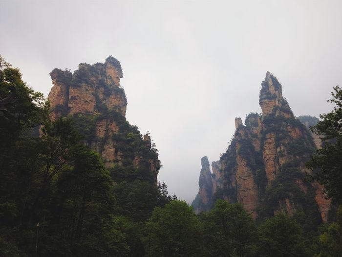 Foggy weather over karst peak of zhangjiajie Karst Mountain Travel Zhangjiajie Yuanjiajie China Landscape Amazing View Peak