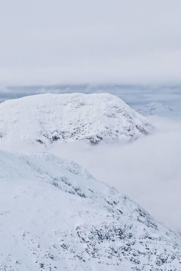 Scottish mountains in winter. Mountain Scottish Scottish Highlands Winter Danger Mountain Rescue Clouds And Sky Clouds Landscape Cold View From Above White White Background Mountains Scenery Wintertime Cold Temperature Background Glencoe Outdoor Photography Outdoors Snow Scotland Scenics Glencoe Mountain Resort