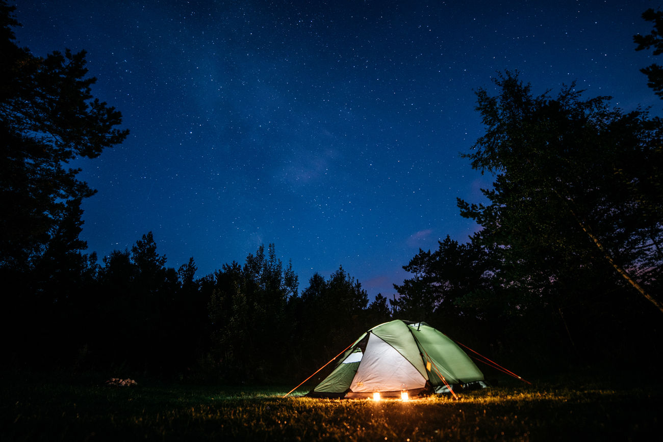 A cosy night in a tent under a star-filled sky in Norway some years ago. I love how less you actually need for a good time. Just a car, a bag pack, a tent. No timetables, no pre-booked hotels or designated travel routes. The total freedom of choice where to go, to stay and when. This is happiness for me. Adventure Astronomy Beauty In Nature Camping Constellation Forest Galaxy Hiking Igniting Landscape Milky Way Mountain Nature Night Outdoors People Remote Scenics Sky Space Star - Space Tent Travel Tree Vacations