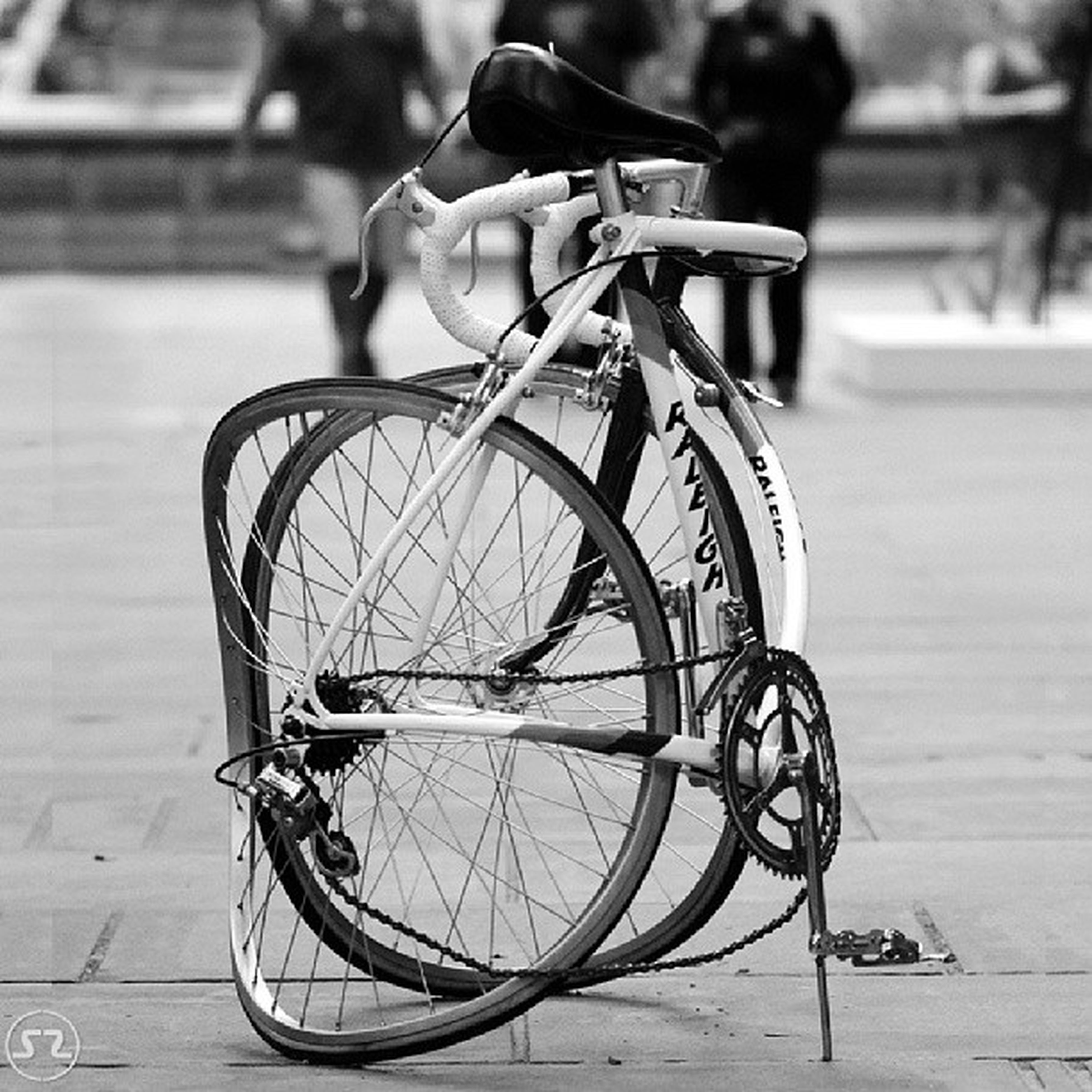 bicycle, transportation, mode of transport, land vehicle, stationary, focus on foreground, parking, parked, wheel, street, metal, close-up, day, outdoors, no people, absence, travel, sunlight, tire, selective focus