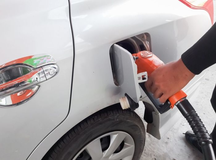 Car Close-up Day Filling Fuel And Power Generation Fuel Pump Gasoline Human Hand Land Vehicle One Person Outdoors Refueling Transportation