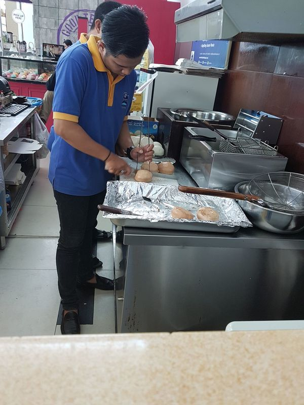 One Person Looking Down Bread Breads Roti Mantau Roti Mantau Cabang Bandara Sepinggan