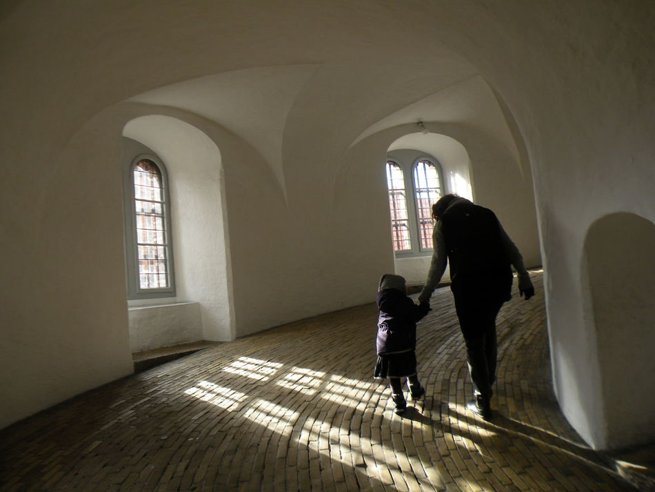 Spiral ramp leading to the viewing platform of the Round Tower in Copenhagen on the island of Zealand in Denmark - Indoors  Window Full Length Sitting Arch Day Dark Domestic Life Young Adult inside the Round Tower in Copenhagen on the island of Zealand in Denmark