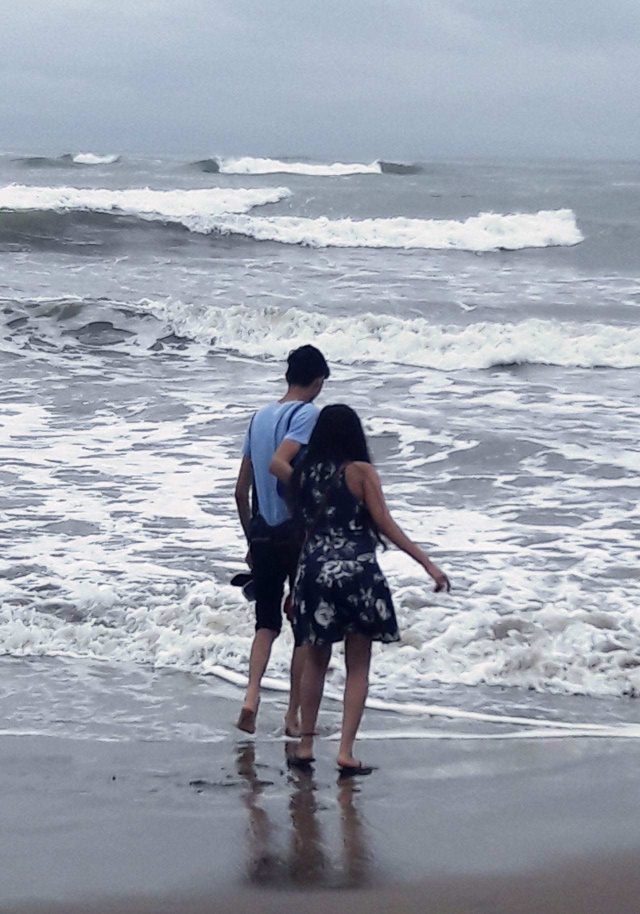 Sommergefühle Two People Togetherness Beach Sea Love Bonding Young Men Standing Ankle Deep In Water Sand Wave Water Horizon Couple Fun Sister Pull Full Length Woman Man Girl Boy Friends Brother EyeEmNewHere