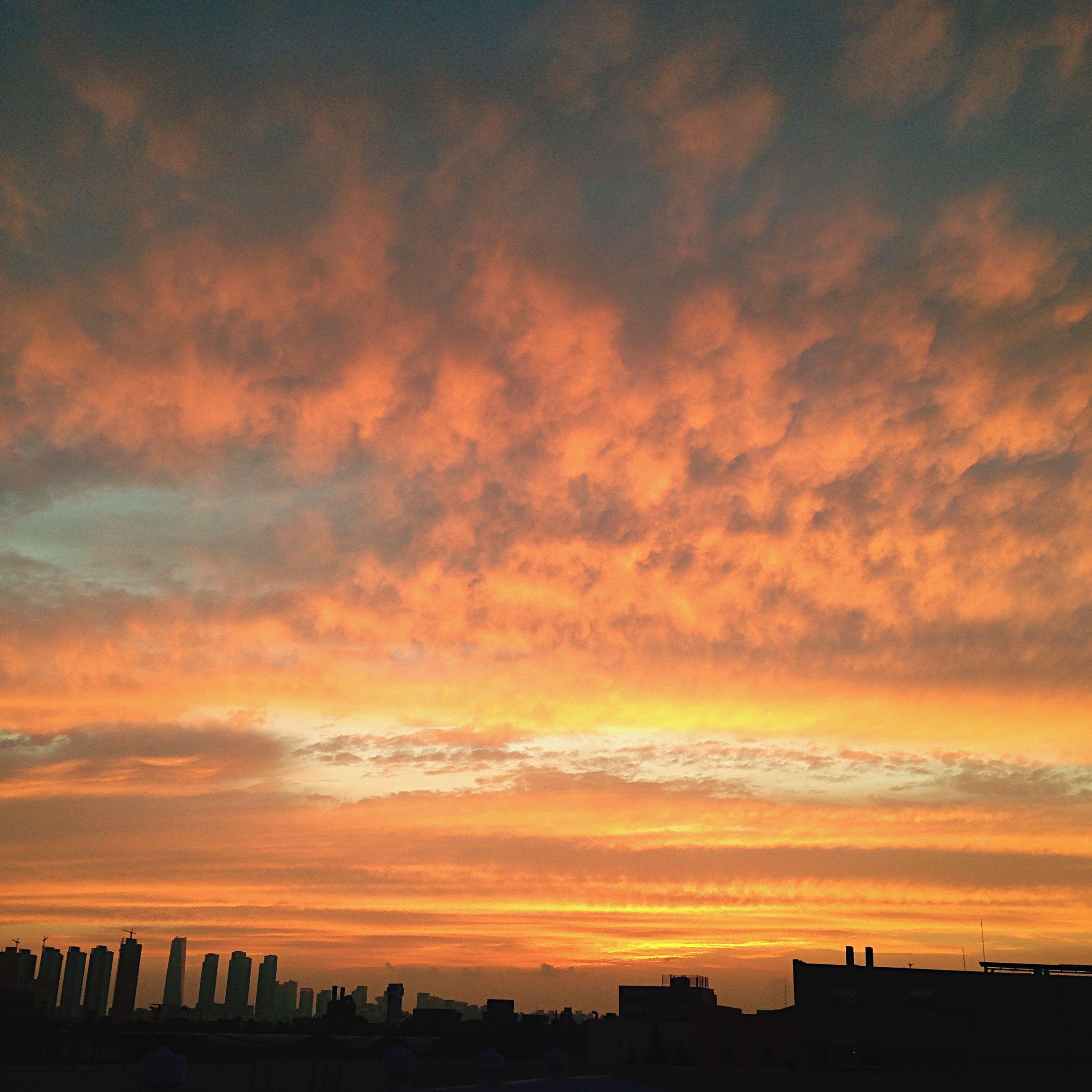 sunset, orange color, building exterior, architecture, silhouette, built structure, sky, cloud - sky, city, beauty in nature, scenics, dramatic sky, cloud, nature, cityscape, cloudy, outdoors, idyllic, building, no people