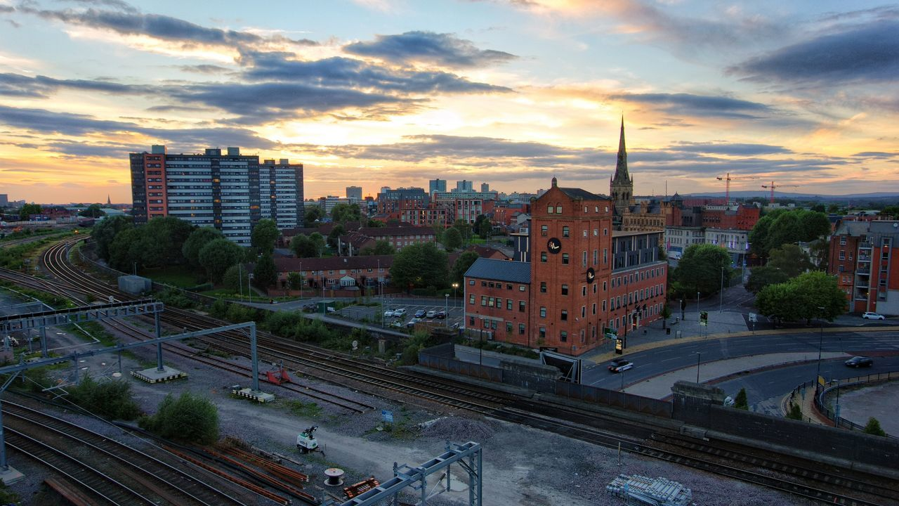 Salford Sunday Sunset High Angle View Railroad Track City Sunset Sky Blue Sky Salford Manchester Red Brick Built Structure Architecture Building Exterior Railroad Track High Angle View Transportation City Rail Transportation Sunset Public Transportation Cityscape Travel Destinations City Life Public Transport Tower Sky