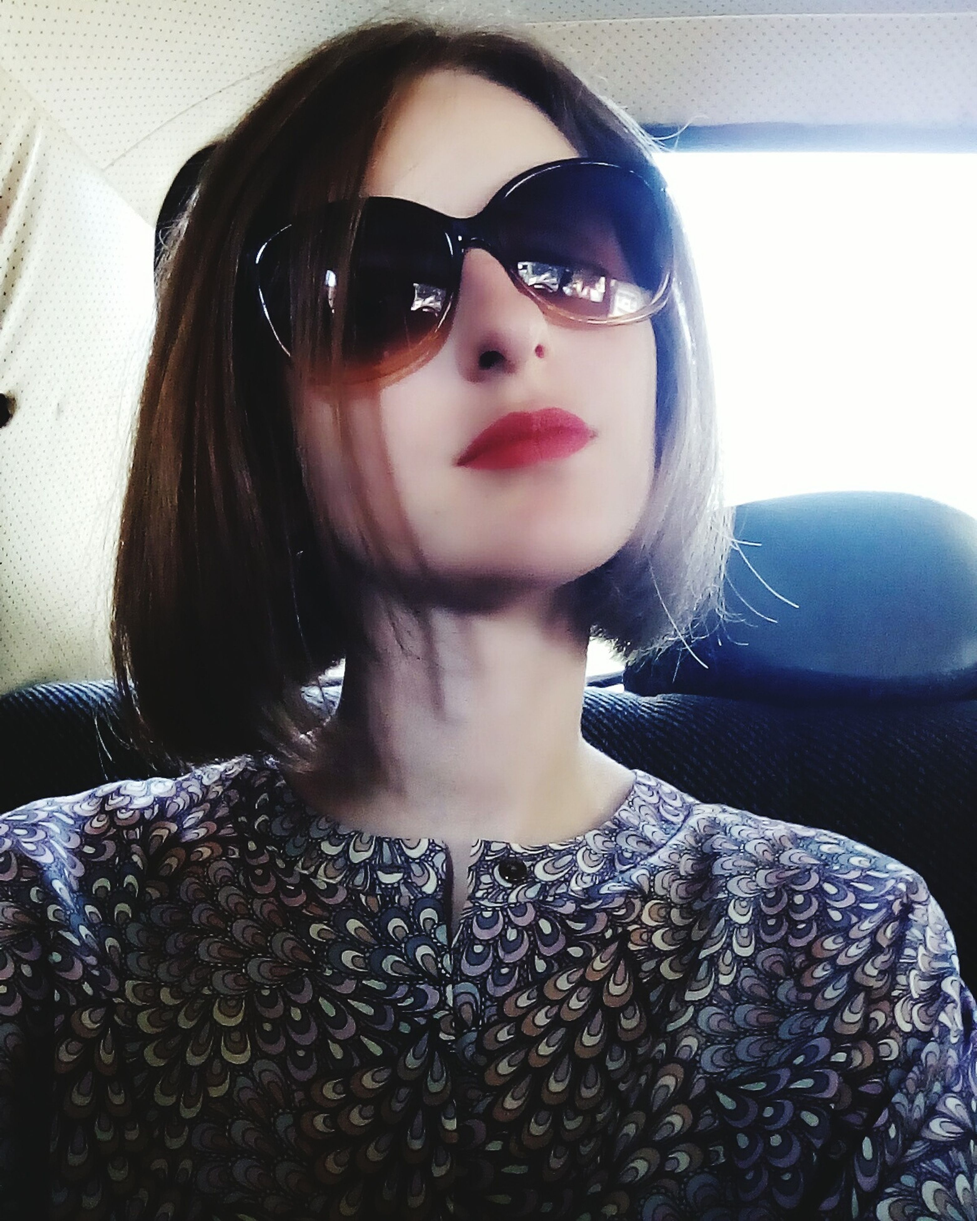 sunglasses, looking at camera, front view, real people, portrait, young women, young adult, one person, beautiful woman, fashion, lifestyles, leisure activity, day, attitude, red lipstick, indoors, warm clothing, close-up