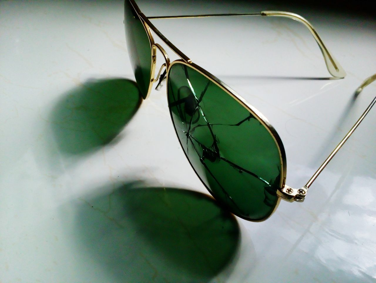 Ray-Ban cracked....emm Glasses Close-up Shadow Green Color Vision Eyesight No People Man Made Object Glass Reflection Glasses :) Glass Objects  Check This Out Broken Glass Broken Rayban RayBans® Rays Of Light Raybansunglasses RaybanAviator Rayban Style Raybanvision Rayban Aviators