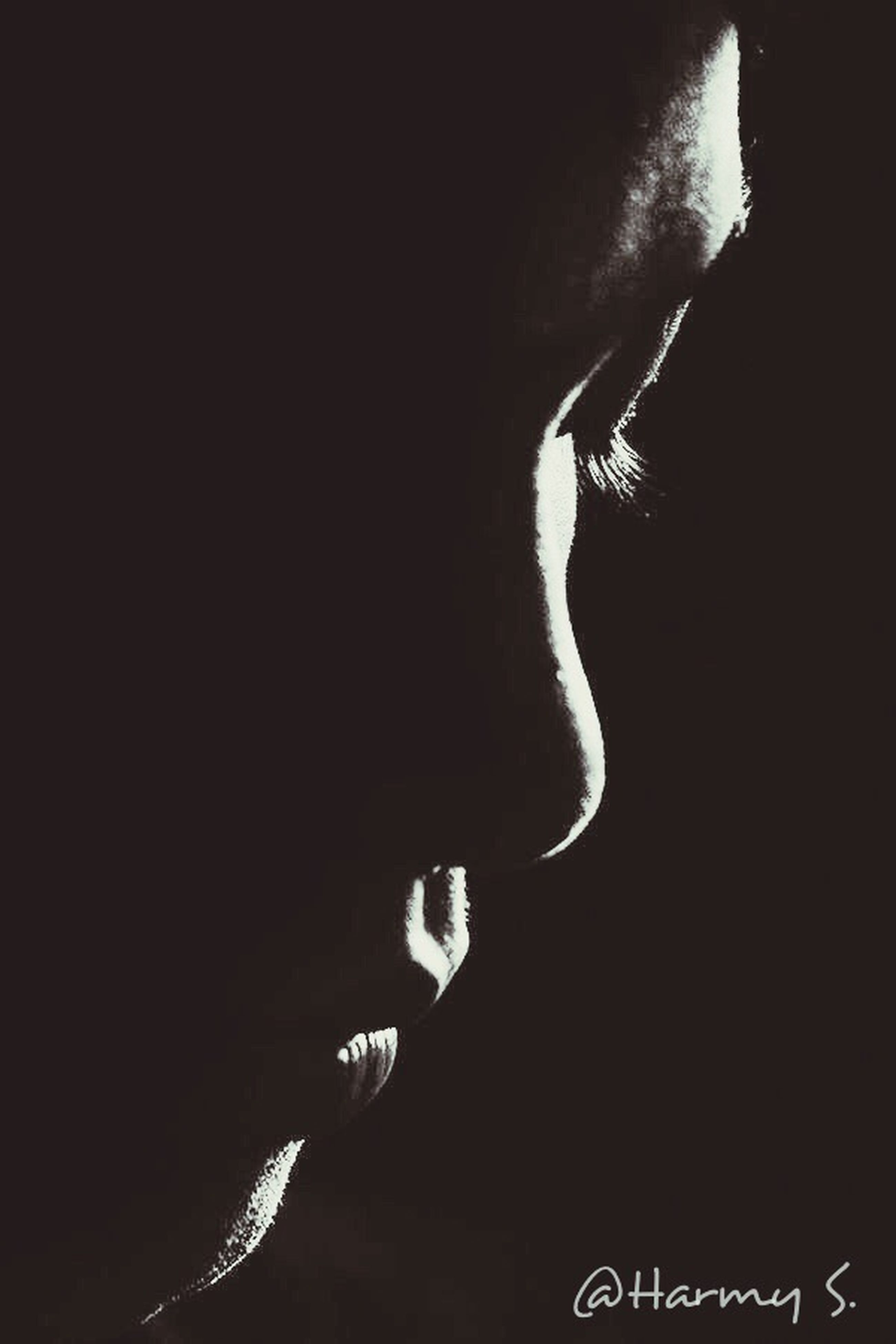 one person, black background, close-up, studio shot, human face, human body part, lifestyles, indoors, real people, young adult, adult, day, people
