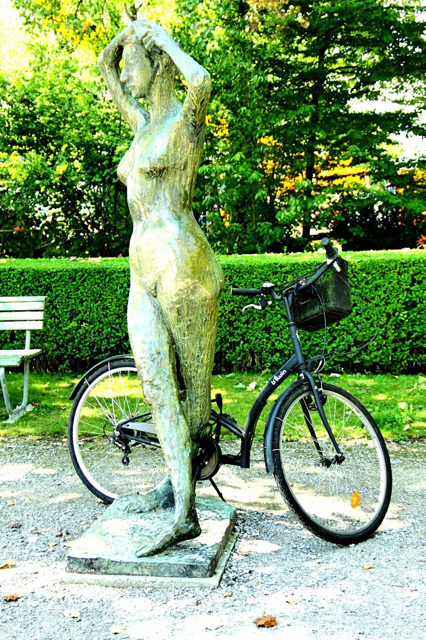 statue, day, bicycle, tree, no people, green color, sculpture, park - man made space, outdoors, growth, transportation, nature, grass, close-up