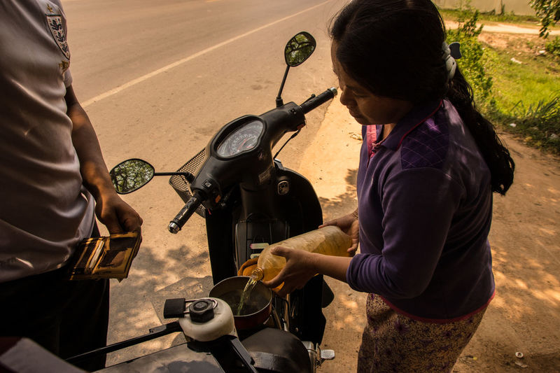 Refueling People Adult Day Real People Adults Only Occupation One Person Outdoors The Street Photographer - 2017 EyeEm Awards EyeEmNewHere The Portraitist - 2017 EyeEm Awards Gasoline Cambodia Travel Adventure Bike Transportation