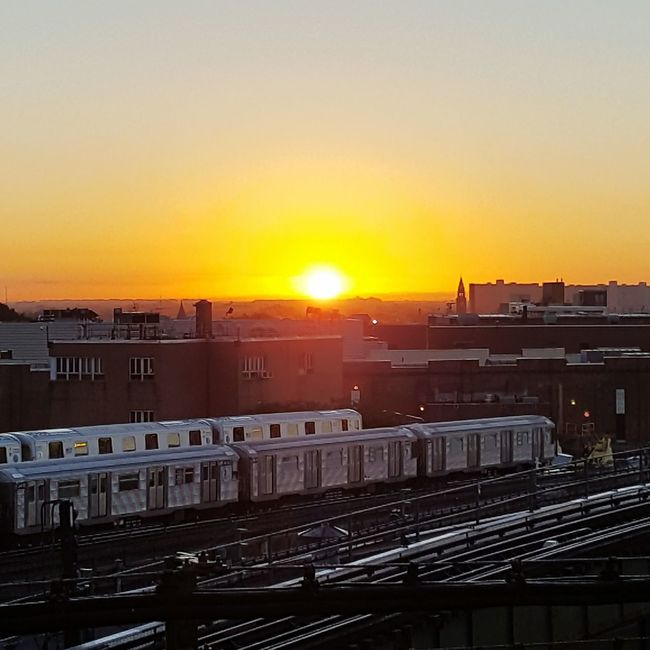 This morning's sunrise over the train yard. Sunset Architecture Building Exterior Built Structure Sun City High Angle View Residential Structure Cityscape Orange Color Residential Building Transportation City Life Railroad Track Residential District Romantic Sky Sky Railroad Station Outdoors Lens Flare NYC EyeEm City Urban Lifestyle NYC Photography