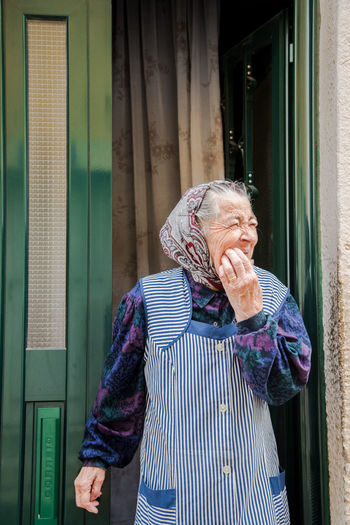 EyeEm Best Shots EyeEmNewHere Faces Of EyeEm Portrait Of A Woman Portraits Portugal Travel Photography Woman Building Exterior Casual Clothing Happiness Leisure Activity Lifestyles Lisbon One Person Outdoors People Portrait Real People Senior Adult Senior Women Standing Street Photography Streetphotography Woman Portrait