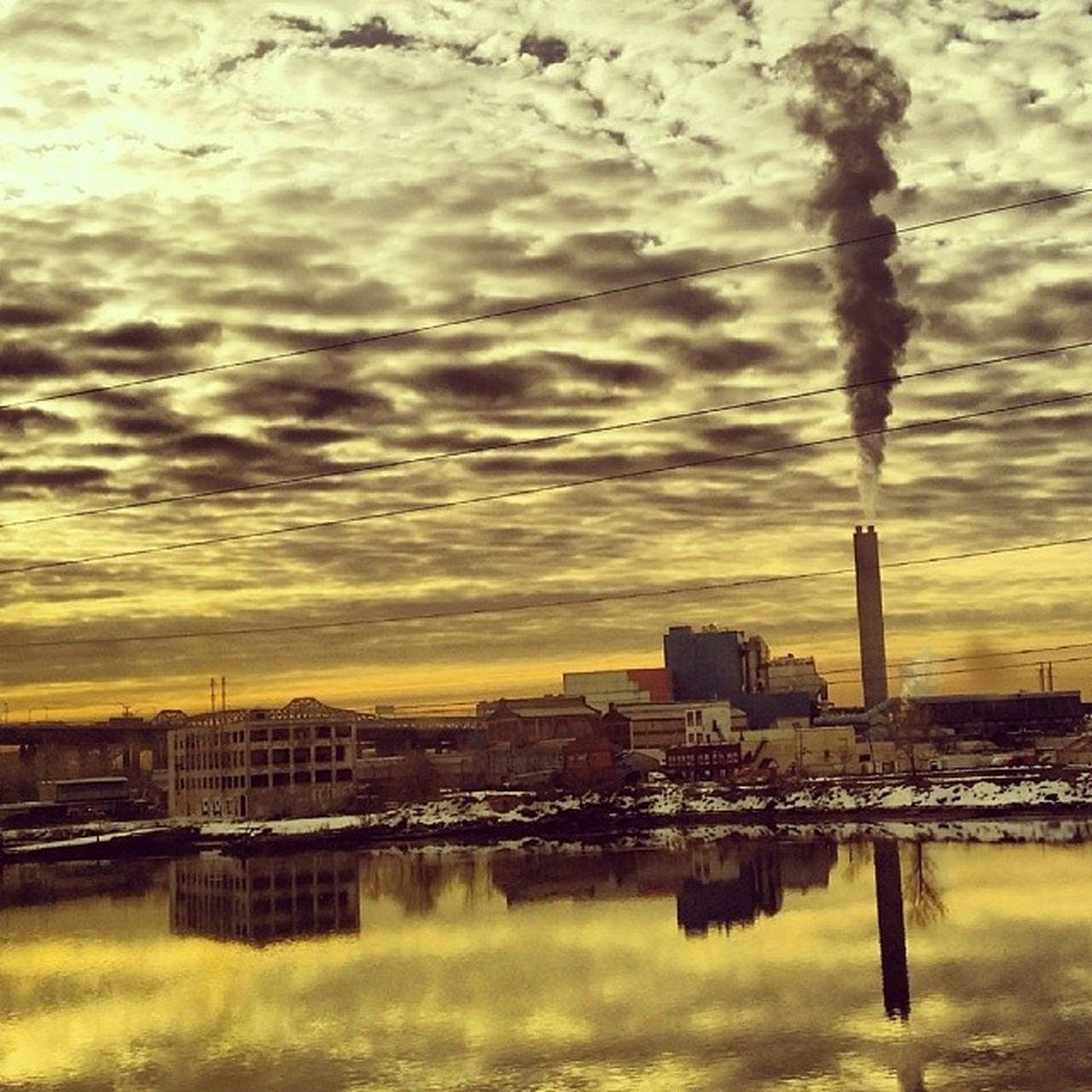 smoke stack, built structure, architecture, building exterior, water, sky, smoke - physical structure, emitting, pollution, chimney, industry, factory, no people, cloud - sky, waterfront, river, sunset, fumes, outdoors, tall, city, nature, cityscape, day, vapor trail
