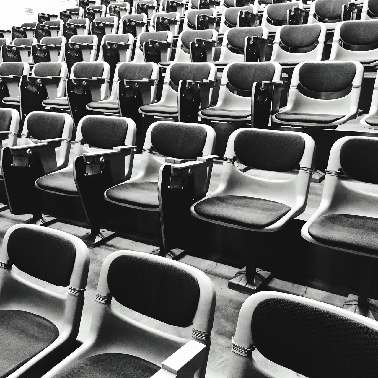 in a row, chair, empty, seat, absence, repetition, arts culture and entertainment, auditorium, indoors, audience, arrangement, folding chair, stadium, day, people