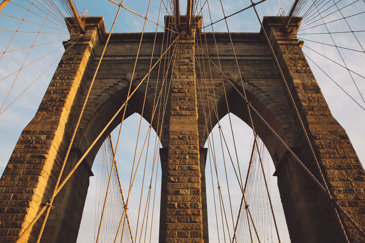 connection, bridge - man made structure, engineering, suspension bridge, architecture, low angle view, built structure, transportation, cable, travel, sky, travel destinations, outdoors, no people, day, chain bridge, city