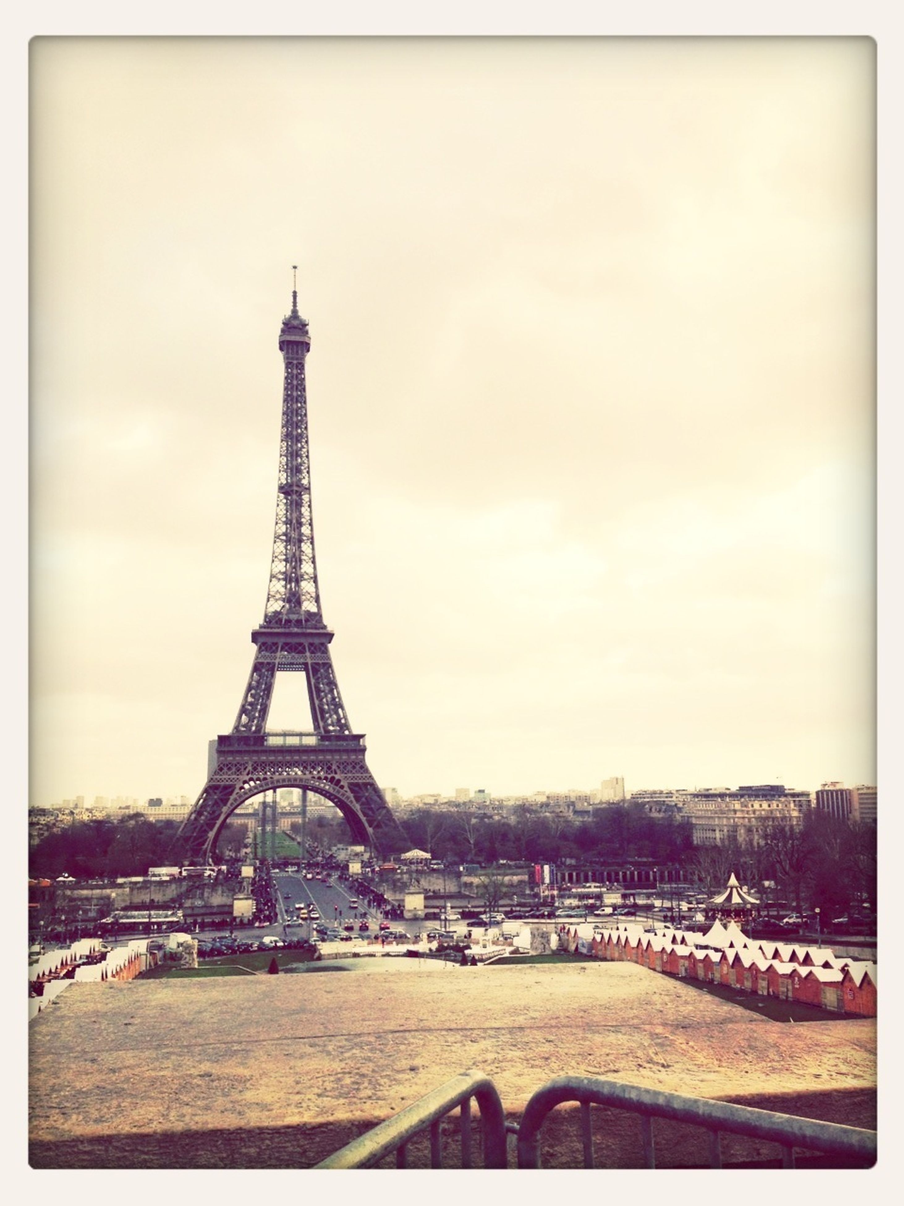 architecture, built structure, eiffel tower, famous place, international landmark, transfer print, building exterior, travel destinations, capital cities, tower, tourism, culture, sky, city, travel, auto post production filter, history, tall - high, metal, architectural feature