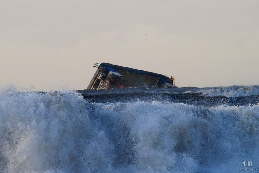 """In February 2016 the service platform """"Sea Worker"""" stranded on the danish coast near Hegnet, between Nymindegab and Børsmose. A few days later she capsized because of strong winds. Rescue work has been done during the year, but they paused because of bad weather conditions in winter. I took this photo in January. Service Platform Oil Industry Northsea Sea Capsized Stranded Disaster Water Wave Crashing Waves  Splashing Sinking Waterfront Nautical Vessel Industry Oil And Gas Denmark Denmark 🇩🇰 Børsmose Strand Nymindegab EyeEm Masterclass Eye4photography  Seascape Ocean Sunken Ship"""