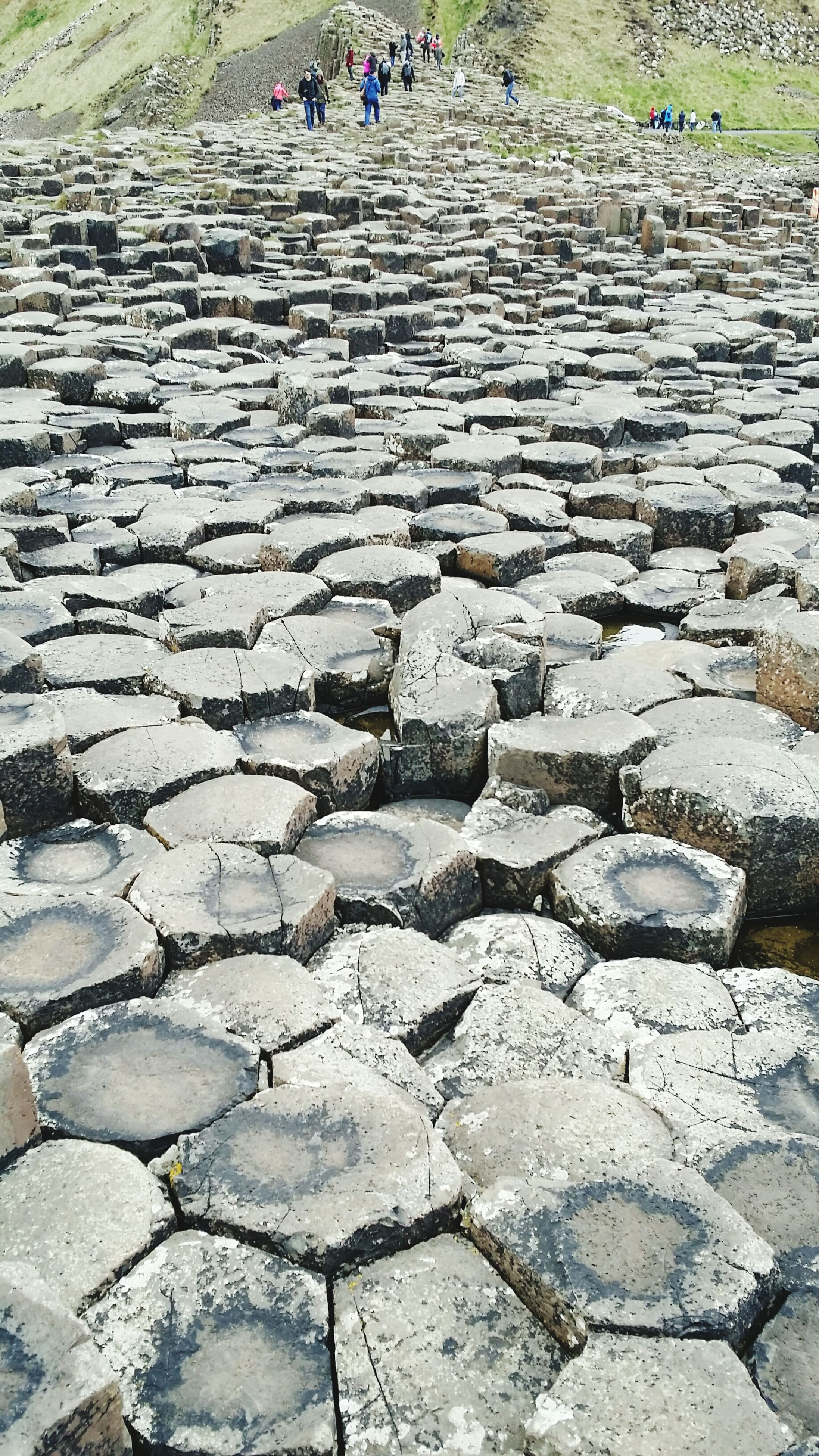 cobblestone, paving stone, stone wall, stone - object, high angle view, stone material, footpath, pattern, street, stone, day, outdoors, rock - object, built structure, sunlight, architecture, steps, pavement, building exterior
