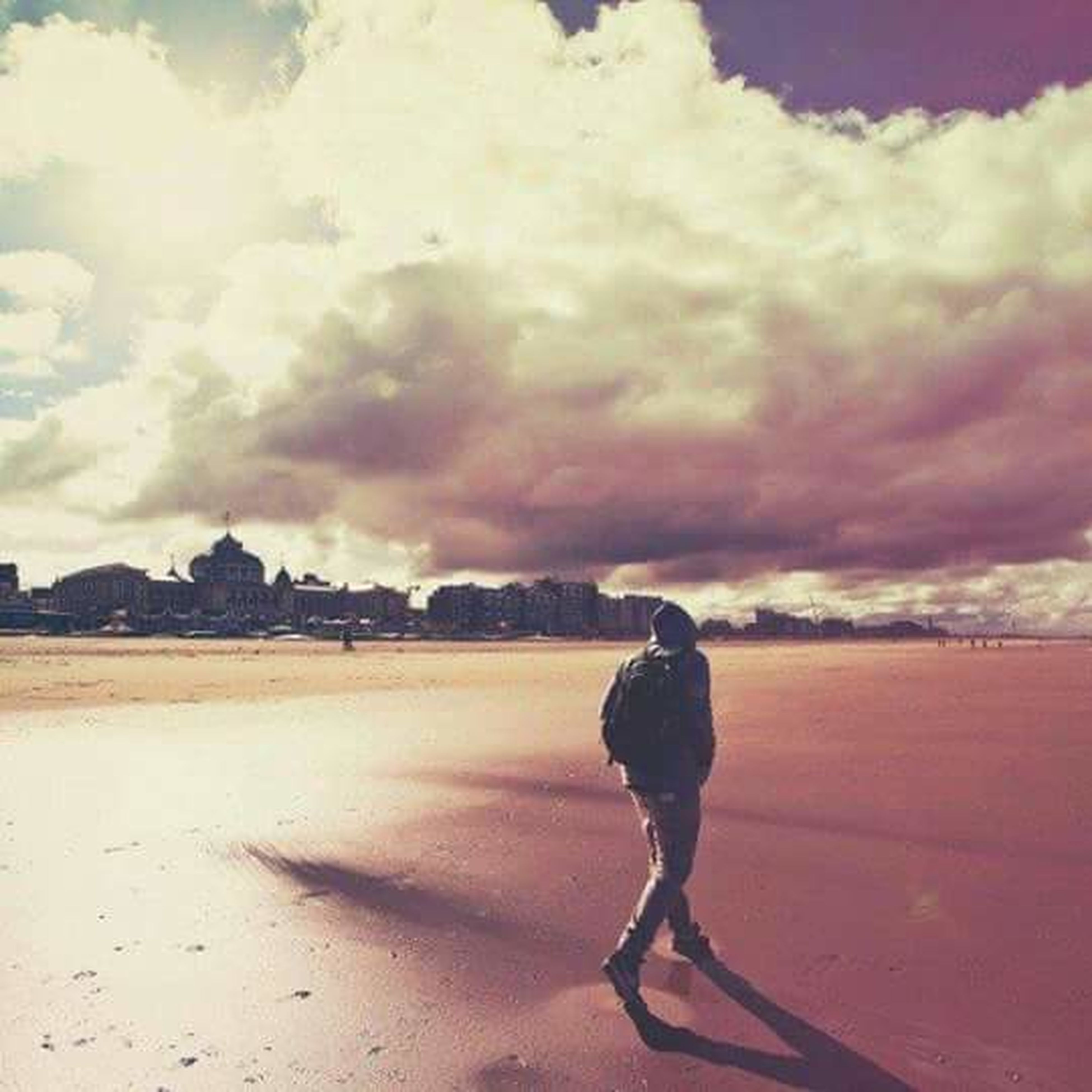 sky, cloud - sky, full length, lifestyles, rear view, leisure activity, cloudy, cloud, standing, tranquil scene, tranquility, scenics, beauty in nature, sunset, weather, nature, water, casual clothing