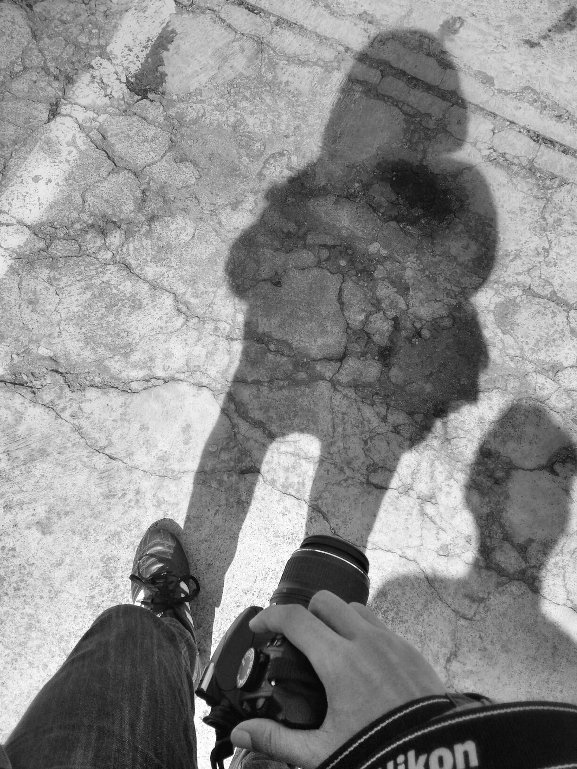 lifestyles, low section, men, leisure activity, personal perspective, person, high angle view, shoe, street, standing, transportation, togetherness, shadow, road, bonding, unrecognizable person
