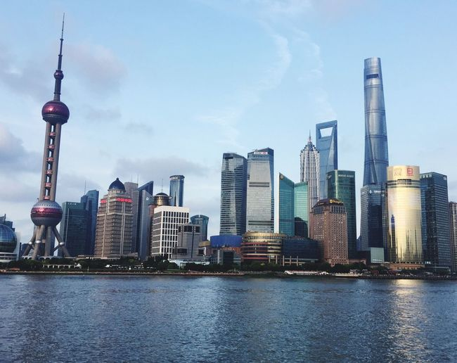 Shanghai waitan Architecture Building Exterior City Skyscraper Modern Tall - High Sky Waterfront Tower River Water Travel Destinations Travel Outdoors Urban Skyline No People Cityscape Cloud - Sky Tall First Eyeem Photo