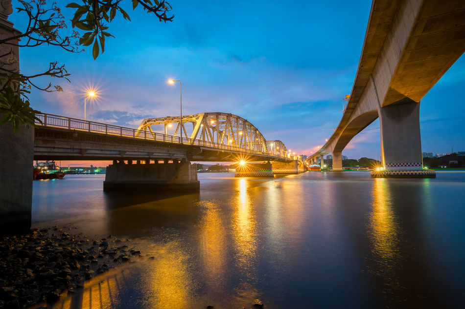 Bangkok bridge in bangkok , Thailand at twilight Arch Bridge Architectural Column Architecture Blue Bridge Bridge - Man Made Structure Built Structure City City Life Cloud Cloud - Sky Connection Engineering Illuminated Long Night No People Outdoors Reflection River Sky Sunset SUPPORT Travel Destinations Water