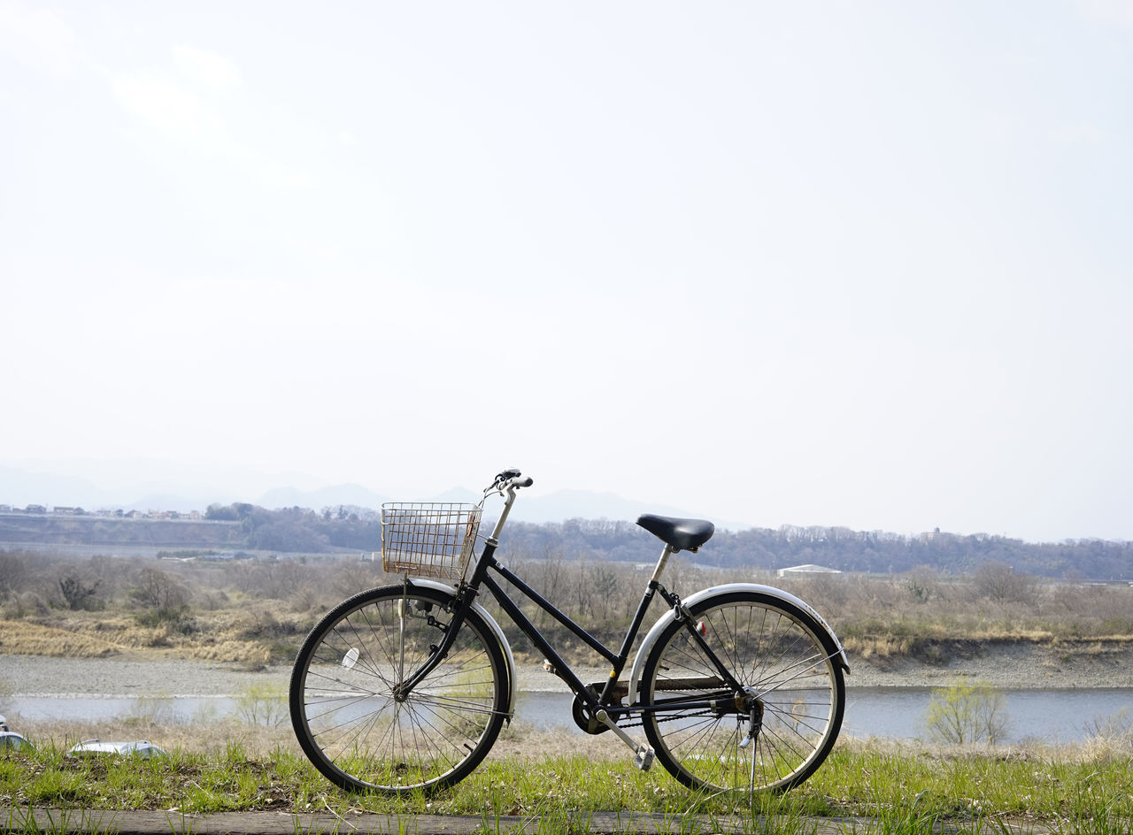 Black old bicycle with river, sky and grass. Beauty In Nature Bicycle Black Blue Sky Cloud Cycling Day Forest Grass Japan Nature No People Old Outdoors River Riverside Sky Tranquility Transportation Tyre Vacations Vintage
