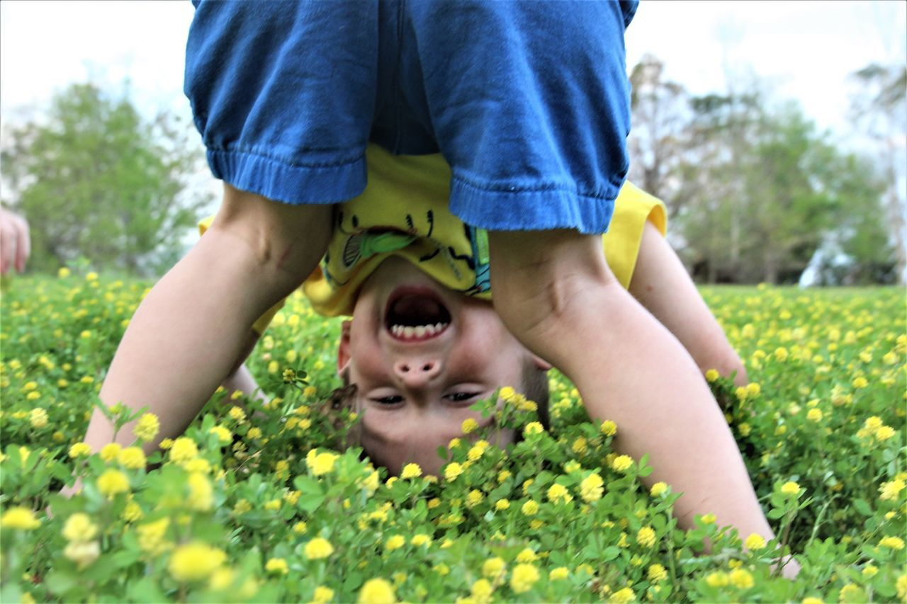 Boy Flowers Fun Laughing One Boy One Boy Only Playing Silly Spring Toddler  Toddler Boy Yellow The Portraitist - 2017 EyeEm Awards