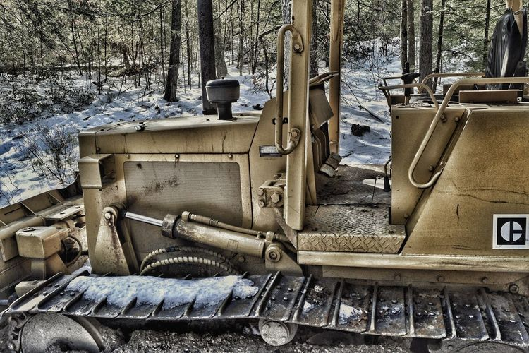 Abandoned No People Day Outdoors Catterpillar Cold Temperature Close-up Snow Low Angle View Catterpilar Machine Woods