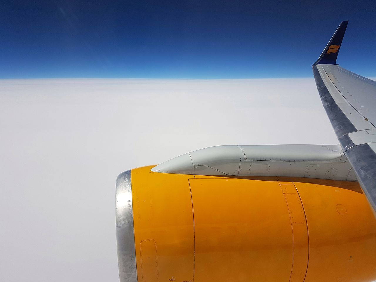 Airplane Cold Temperature Sky Travel Flight Engine Jet Transportation Above The Clouds Blue Sky Clouds Yellow Bright Day Wing Lifestyles