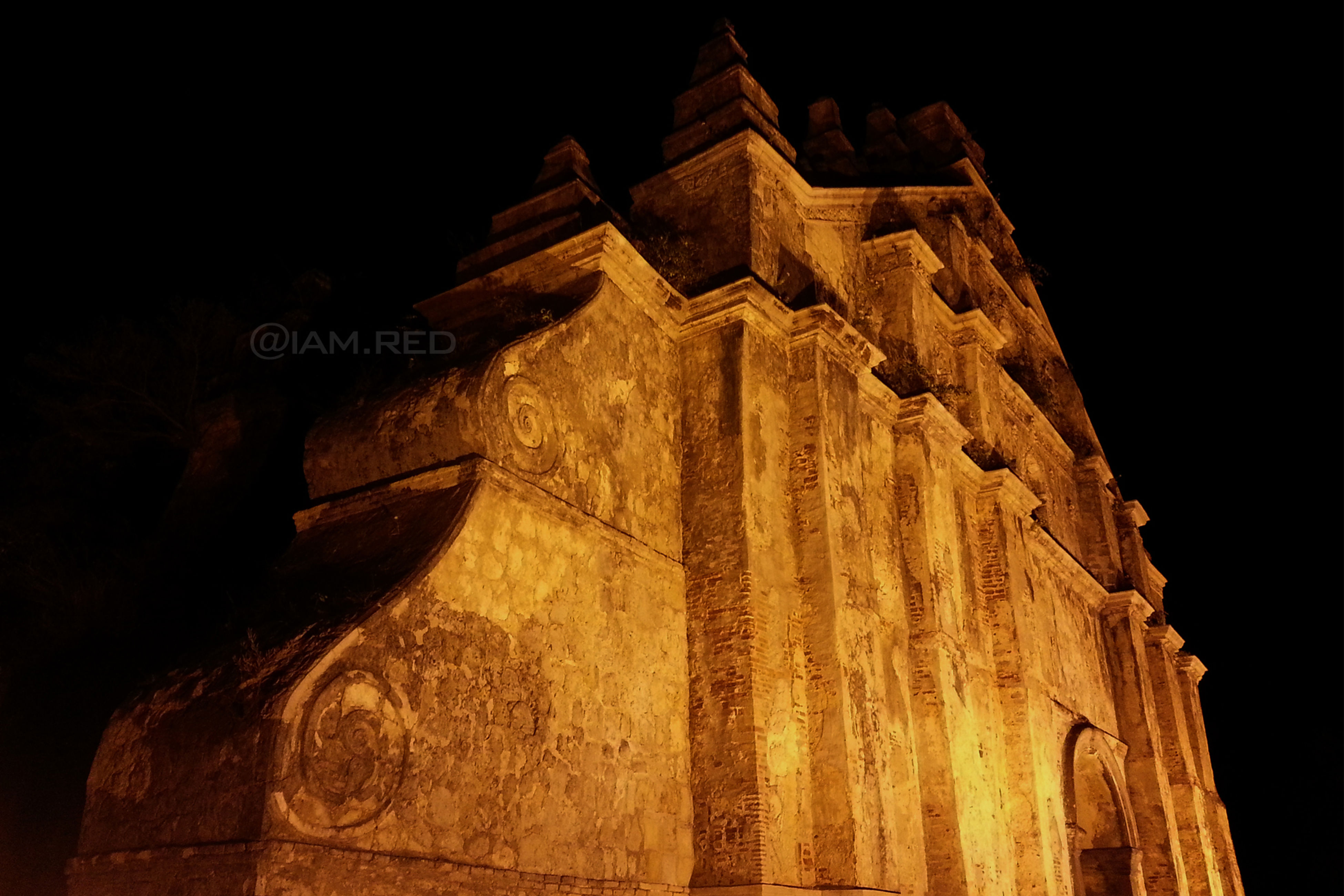 night, built structure, architecture, illuminated, building exterior, low angle view, history, clear sky, famous place, religion, travel destinations, old, ancient, text, spirituality, place of worship, outdoors, dark, no people, temple - building
