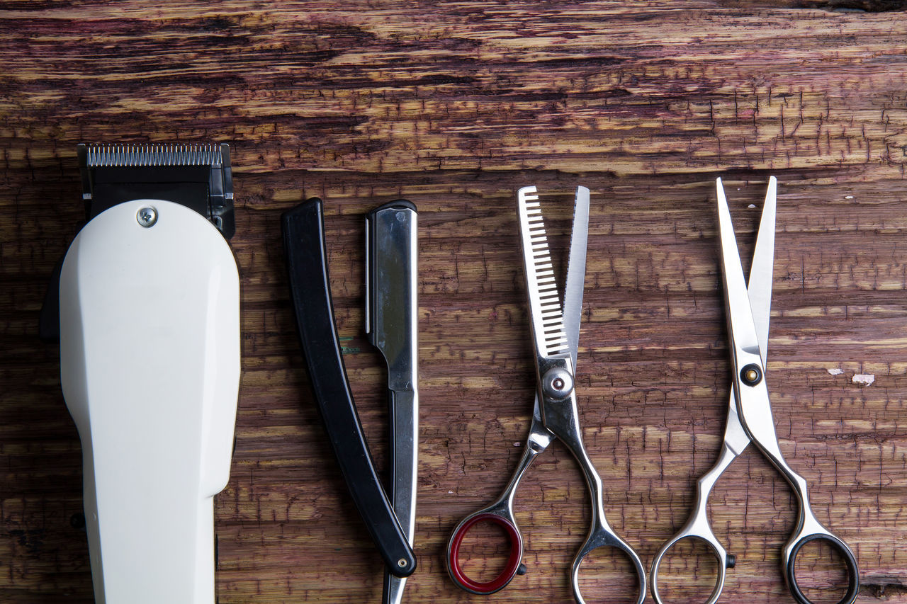 Stylish Professional Barber Clippers, Hair Clippers, Haircut accessories on wood background with copy space Accessory Appliance Background Barber Beard Beauty Blade Clipper Clipping Closeup Comb Cut Cute Equipment Fashion Hair Hair Clipper Haircut Hairdresser Hairdressing Hairstyle Professional Shave Stylish Tool