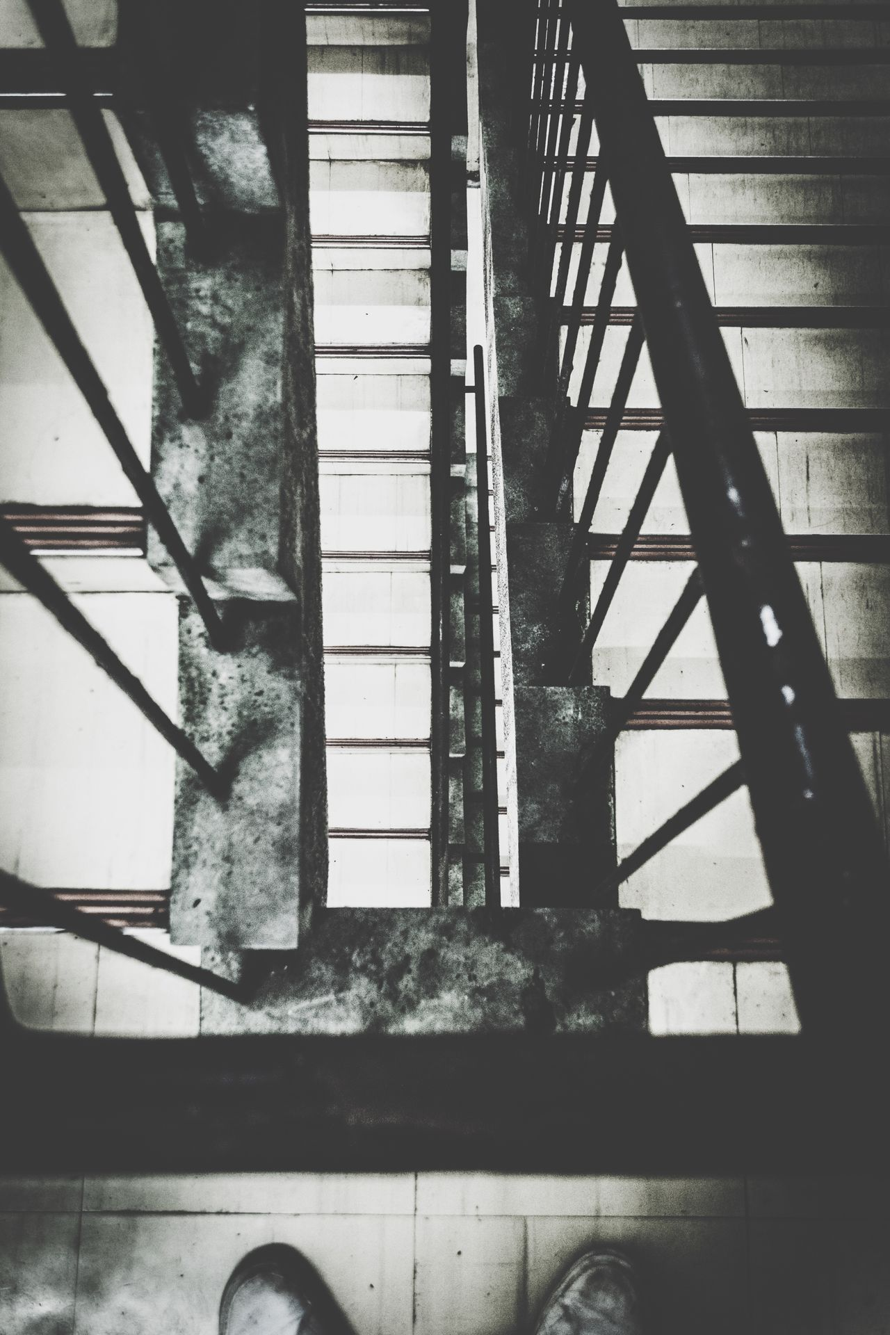 Stairs Drastic Edit Footscapes From My Point Of View View From Above Dark Darkness And Light Best Of Stairways Showing Imperfection Monochrome B&w Street Photography Share Your Adventure Streetphotography Stairways Up Close Street Photography Ominous The Darkness Within Light And Shadow Black & White Silence Pattern Pieces Urban Geometry Going The Distance Life In Motion Gangsters Paradise Resist