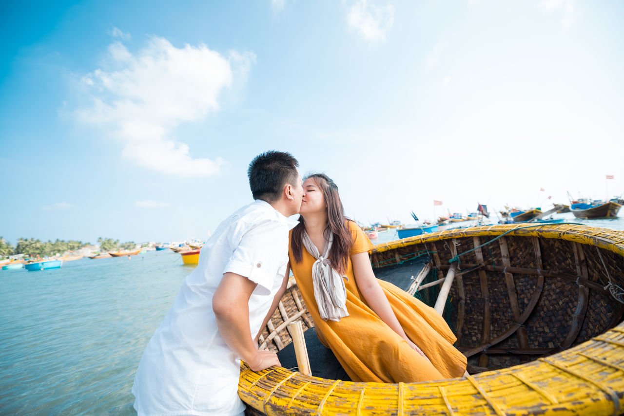 Adults Only Affectionate Beach Blue Bonding Boyfriend Carefree Couple - Relationship Girlfriend Heterosexual Couple Love Men Mid Adult Relaxation Romance Sea Sky Smiling Summer Sunlight Togetherness Travel Two People Vacations Women